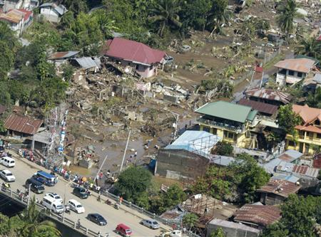 Aerial view of damages caused by flash floods brought by Tropical Storm Sendong in Cagayan De Oro. Image Credit: REUTERS/Stringer