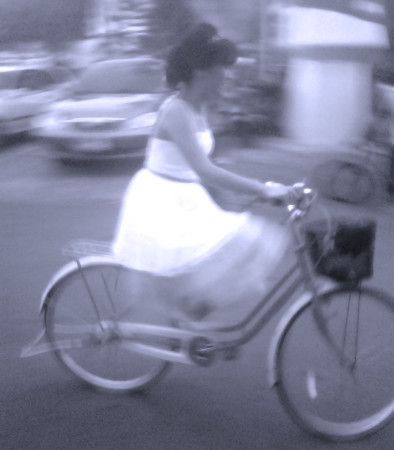 Bride on a bicycle.