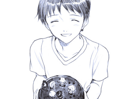 Shinji holding a birthday cake.
